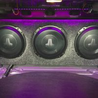 purple jl audio speakers in trunk